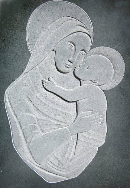Hand carved green slate relief Madonna and child