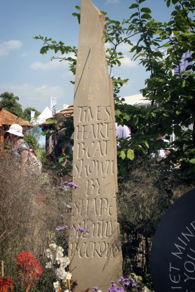 Hand carved York stone standing sundial - poem and carving by Martin Cook