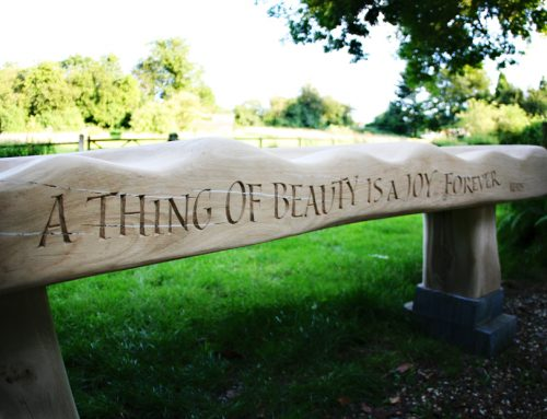 Oak bench with carved verse